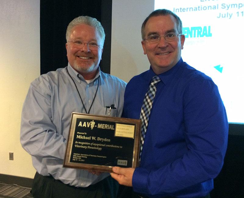 Dwight Bowman presenting Merck Award to Michael Dryden
