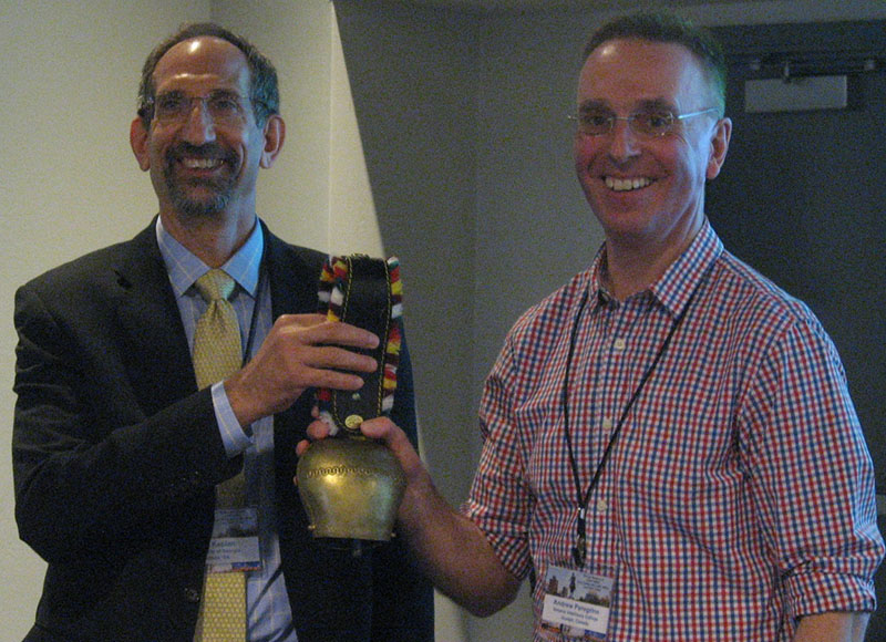 Ray Kaplan presenting Cow Bell to Andrew Peregrine