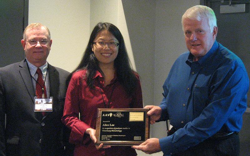 Tom McTier and Joe Hostetler presenting 2015 CAPC Award to Alice Lee